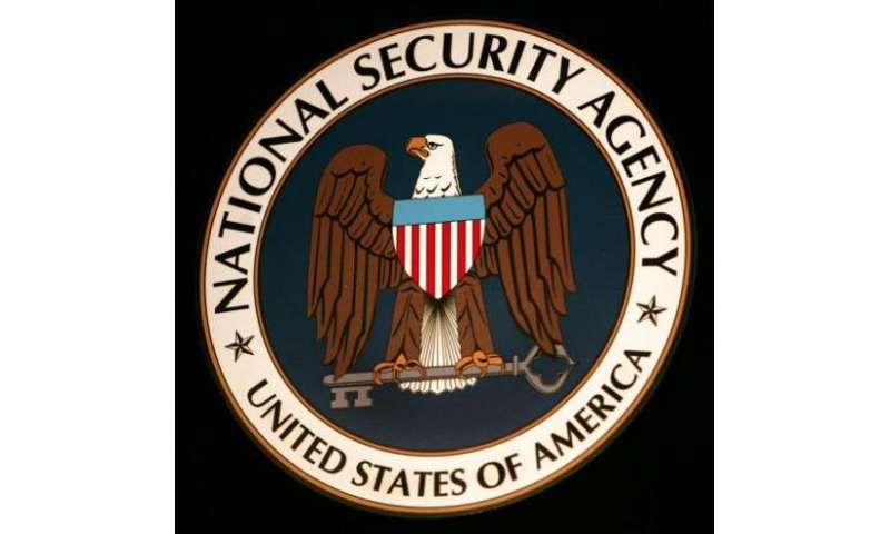 The logo of the National Security Agency hangs at the Threat Operations Center in Fort Meade, Maryland on January 25, 2006