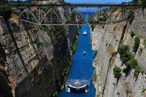 "The world's largest solar-powered boat, ""MS Turanor PlanetSolar"" sails through the Corinth Canal near the town of Cori"