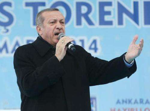 Turkey's Prime Minister Recep Tayyip Erdogan delivers a speech in Ankara March 13, 2014
