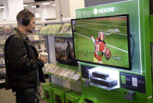 A customer looks at a display of Microsoft's Xbox One at Best Buy in Union Square in New York on November 19, 2013