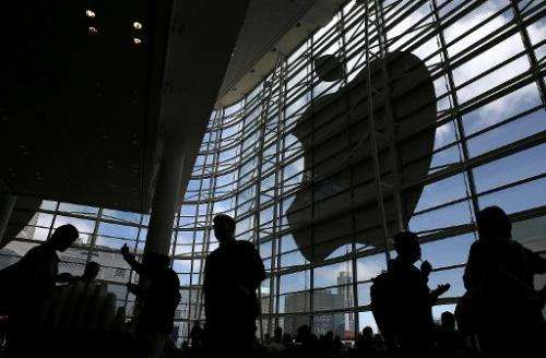 Attendees gather at the Apple Worldwide Developers Conference at the Moscone West center on June 2, 2014 in San Francisco, Calif