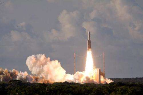 File photo shows an Ariane-5 rocket carrying two telecommunication satellites Eutelsat 25B/ Es'hail1 (France/Qatar) and GSAT-7 (