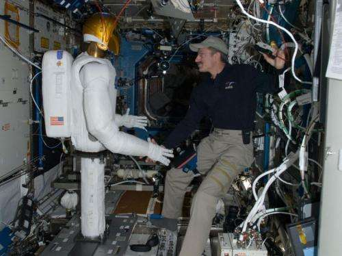 Lower limbs for Robonaut 2 are aboard the International Space Station