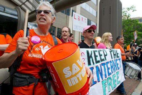 "Protesters hold a rally to support ""net neutrality"" and urge the Federal Communications Commission (FCC) to reject a p"