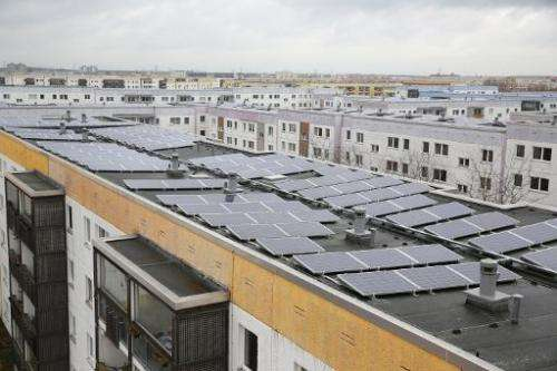 This file photo shows a roof-top solar power project in Berlin, Lichtenberg's 'Yellow Quarter' district, pictured on March 19, 2