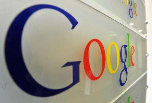 Google logo is seen on a wall at the entrance of the Google offices in Brussels on February 5, 2014