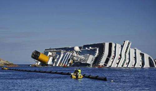 Picture taken on January 26, 2012 shows the stricken cruise liner Costa Concordia lying aground in front of the Isola del Giglio