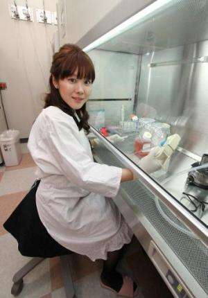 Haruko Obokata, a Riken Institute researcher, works in her laboratory in Kobe in Hyogo prefecture, western Japan on January 28,