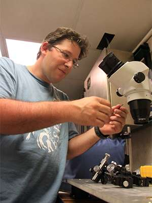 Marine biologist examining deep-sea vision on cruise to Barbados, Bahamas