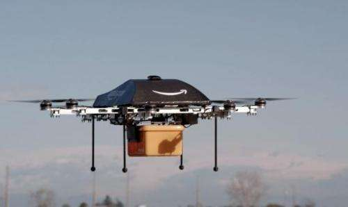 "A handout photo released by Amazon on December 1, 2013 shows a flying ""octocopter"" mini-drone that would be used to fl"