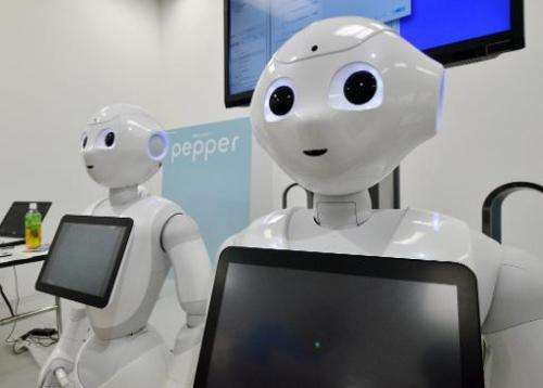 "A file picture taken on June 28, 2014 shows Japanese mobile communication giant Softbank's humanoid robot ""Pepper"" dis"