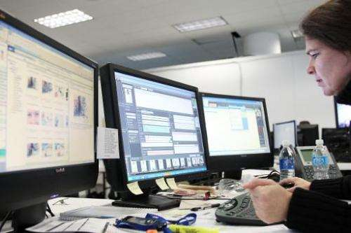 File picture shows an AFP journalist looking at computer screens in Vancouver on February 25, 2010 during the Winter Olympics