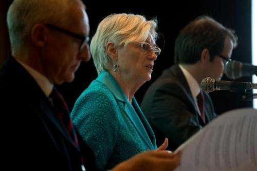 International Energy Agency executive director Maria van der Hoeven (C) speaks during a press conference in Seoul on May 12, 201