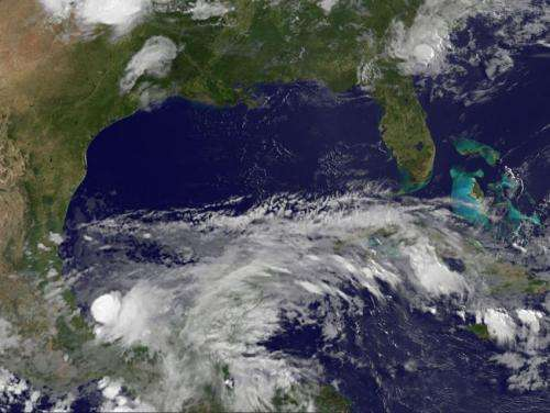 NASA and NOAA satellites eyeing Mexico's tropical soaker for development