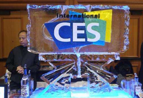 A bartender serves drinks during the first press event 'CES Unveiled' at the Mandalay Bay Convention Center prior to the 2014 In