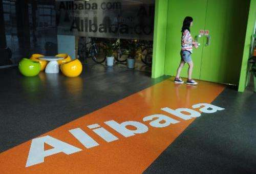 A Chinese Alibaba employee walks through a communal space at the company headquarters in Hangzhou on June 20, 2012