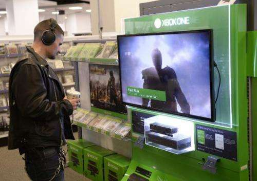 A customer looks at a display of Microsoft's next-generation console, the Xbox One at Best Buy in Union Square in New York on No