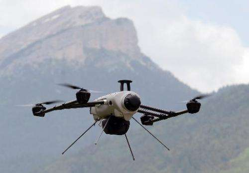 A Delta drone flies over the Chartreuse mountain range during a training session on June 20, 2013 in eastern France