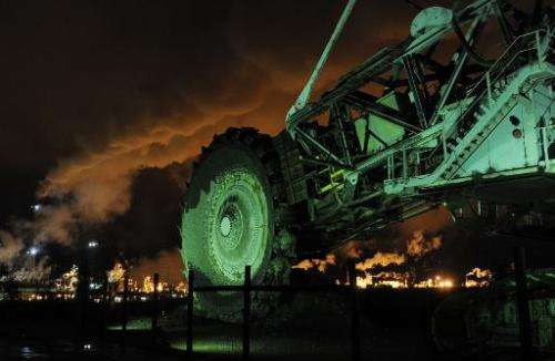 A disused mining machine is displayed in front of the Syncrude oil sands extraction facility near the town of Fort McMurray in A