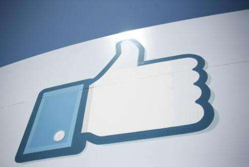 A Facebook Like Button logo at the entrance of the headquarters in Menlo Park on May 10, 2012