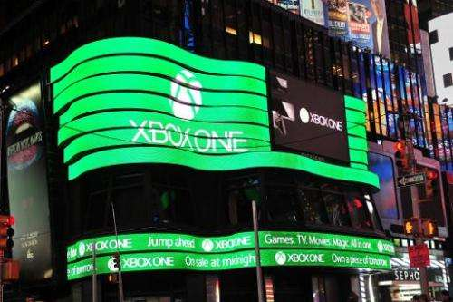 A giant video screen shows the logo for Microsoft's Xbox One game console on November 21, 2013 in New York's Times Square