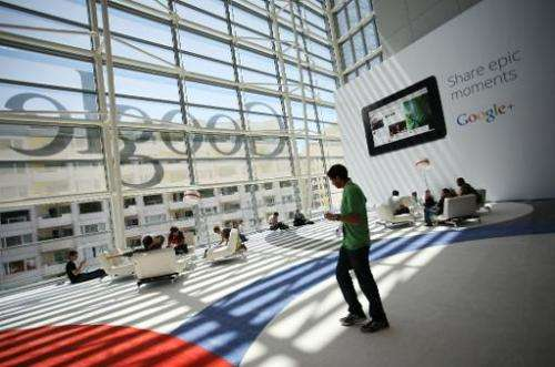 A Google logo is seen through the windows of Moscone Center in San Francisco during Google's annual developer conference on June