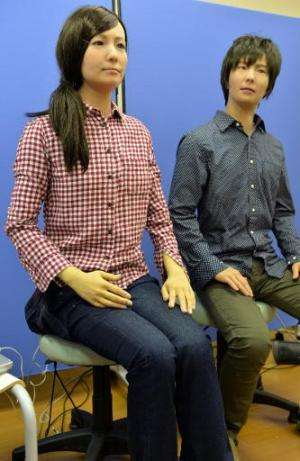 "A male and female humanoid robots called ""Actroid F"", produced by Japan's National Institute of Advanced Industrial Sc"