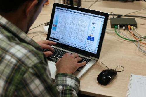 A man attends a hacking challenge in Paris on March 16, 2013