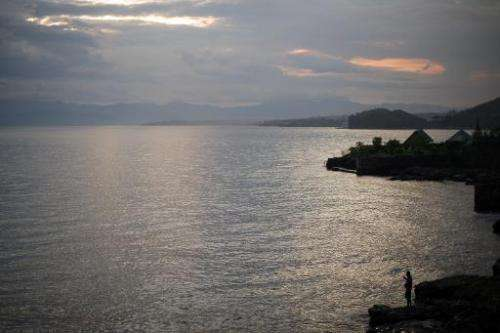 A man fishes on the edge of Lake Kivu on May 28, 2012 near the city of Goma in North Kivu province in the Democratic Republic of
