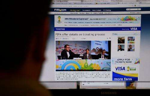 A man reads the a website in Rio de Janeiro on August 20, 2013