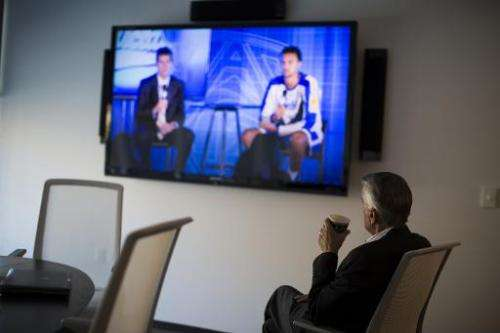 A man watches a live television broadcast October 17, 2013 in San Francisco, California