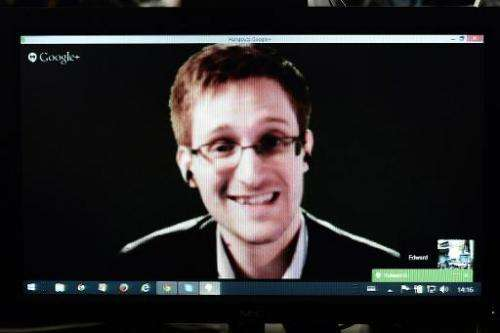 American National Security Agency whistleblower Edward Snowden speaks to European officials via videoconference during a parliam