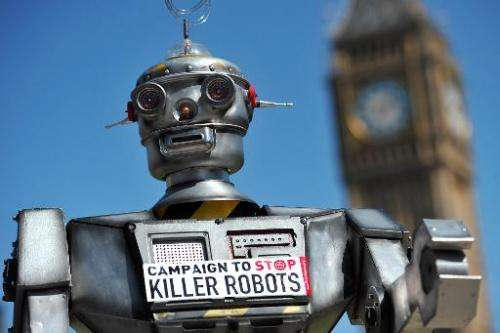 """A mock """"killer robot"""" is pictured in central London on April 23, 2013 during the launching of against lethal robot wea"""