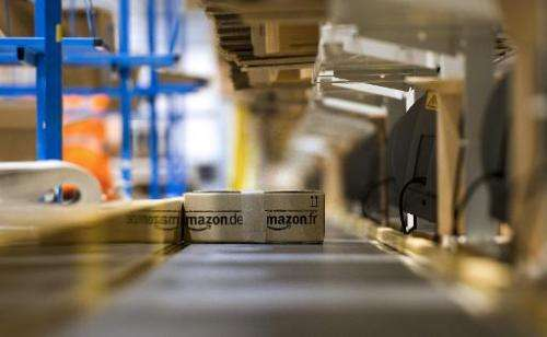 An Amazon parcel is seen on a conveyor belt before being shipped to a client on December 13, 2012