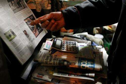 A newspaper vendor in Manhattan's Cooper Square prepares to close up his kiosk on April 4, 2012 in New York City