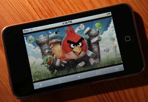 "An image of the popular video game ""Angry Birds"" is displayed on an iPod Touch"