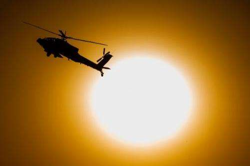 An Israeli AH-64 Apache longbow helicopter performs in the Negev desert on December 26, 2013