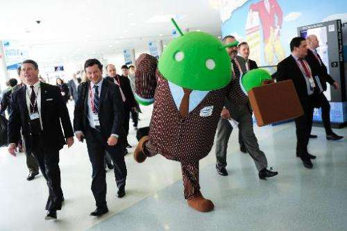 A person dressed up as an Android operating system character greets visitors at the 2014 Mobile World Congress in Barcelona on F