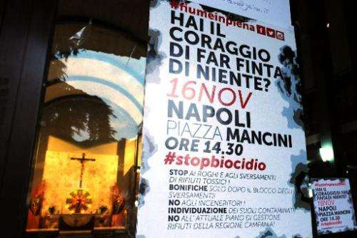 A poster in St. Paul's church in the southern Italian town of Caivano on November 14, 2013, announces a protest in Naples over i