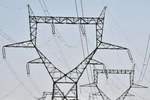 A pylon supports a high voltage line near La Redorte southern France on June 20, 2014