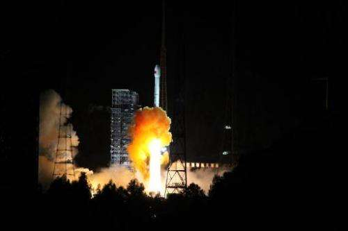 A rocket carrying an experimental spacecraft intended for the moon and back launches from Xichang space base in China's Sichuan