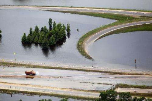 A truck drives along a flooded highway on the Mississippi River on May 23, 2011 in Vicksburg, Mississippi