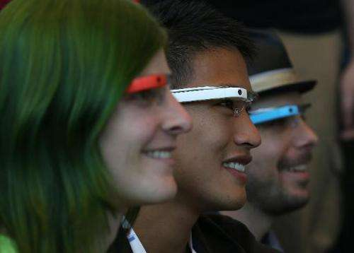 Attendees wear Google Glass while posing for a group photo during the Google I/O developer conference on May 17, 2013 in San Fra