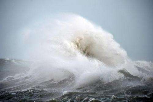 A wave crashes against the breakwater of Lomener in Ploemeur, western France on February 5, 2014 as Brittany and the Atlantic co