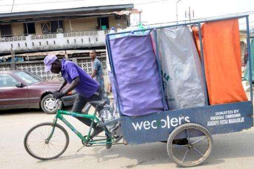 A 'Wecycler' pedals through the streets on his special bicycle, picking up bags of recyclable goods from the customers, who earn