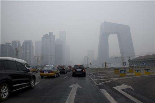 Beijing issues rare air pollution alert