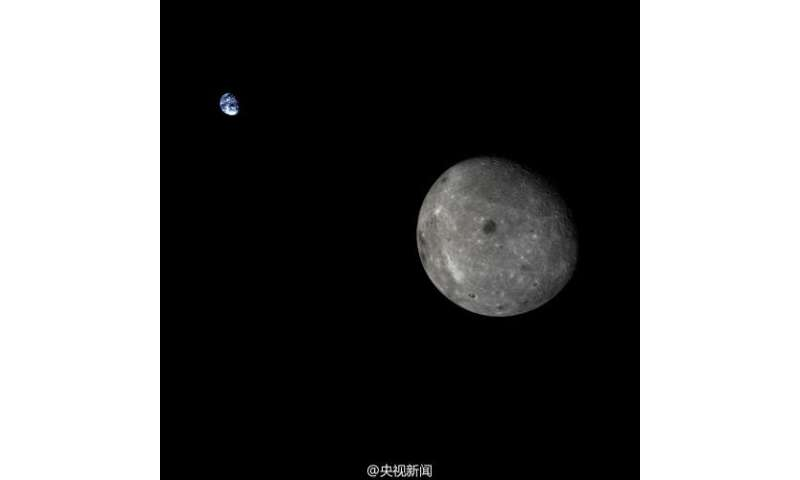 China's lunar test spacecraft takes incredible picture of Earth and moon together