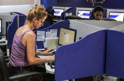 Cubans gather at a cybercafe in Havana on June 21, 2013