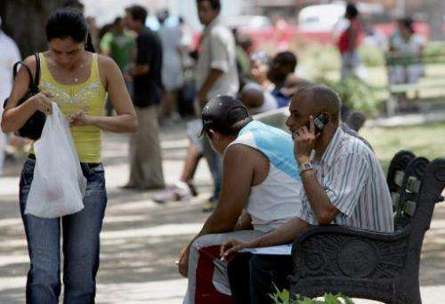 Cubans use their cell phones in Havana on May 8, 2008