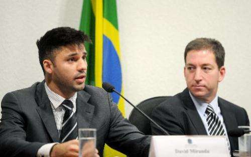 David Miranda (L), partner of the Guardian's Brazil-based reporter Glenn Greenwald (R), speaks before the investigative committe